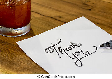 Thank you - Hand writing text on wood background