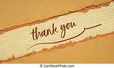 thank you handwriting on a handmade paper in orange and brown tones, web banner