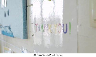 Thank you inscription multicolored letters with glare camera movement