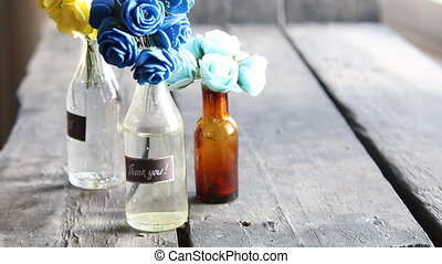 Thank you label and flowers in the bottles - Thank you label...