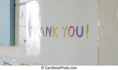 Thank you lettering multicolored letters with glare camera movement