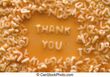 thank you made of food letters in ketchup soup