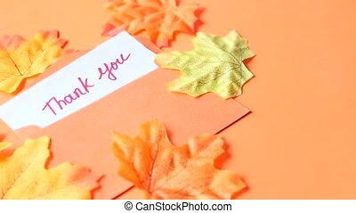 thank you message and envelope on orange background .