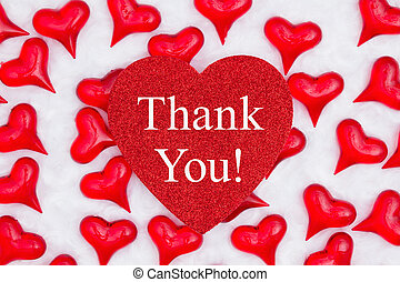 Thank you message on glitter heart with red hearts on white fabric