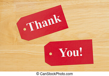 Thank you message on three blank red gift tags