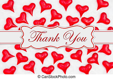 Thank you message with red hearts on white fabric