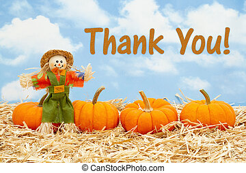 Thank You message with scarecrow and orange pumpkins on straw hay