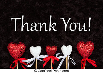 Thank You message with white and red hearts on black