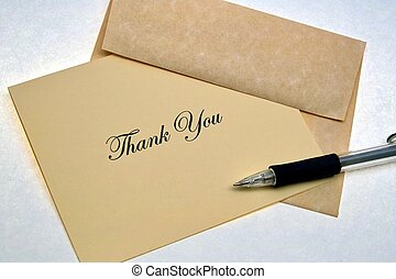 Thank You Note - A thank you note with envelope and pen