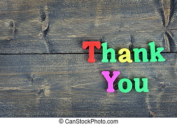 Thank you on wooden table