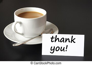 thank you or thanks concept with cup of coffee on black background