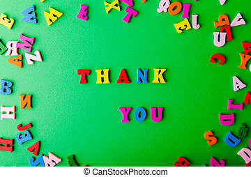 Thank you. Scattered colorful wooden letters