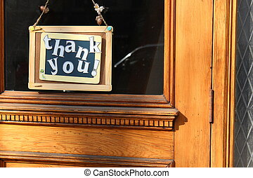 Thank you sign hanging in window