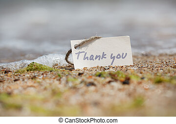 Thank you - sign on the beach