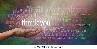 Woman's hand facing palm up with the word 'thank you' floating above surrounded by many different sized thank yous on a stone effect multicolored wide background