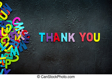 Thank you text on dark background.