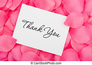 Thank You with Love - A thank you card sitting on a pink ...