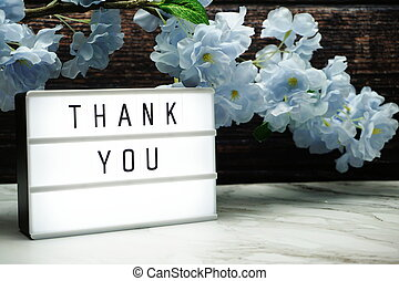 Thank you word in light box with Flowers Decoration