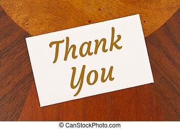Thank you word message on white greeting card wood