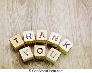 thank you word wooden block on wooden background