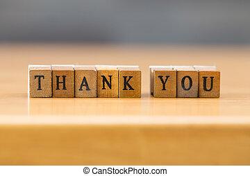 Thank you. word written on wood block