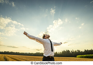 Thankful Businessman with Open Arms at the Field - Half Body...