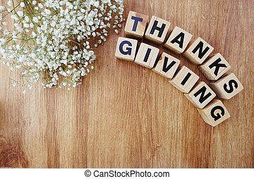 thankgivings alphabet letters on wooden background