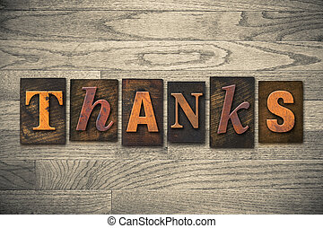 """The word """"THANKS"""" written in wooden letterpress type."""