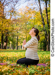 Thanks for baby - Happy pregnant woman giving thanks to god...
