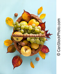 Thanksgiving art; Fruit basket with fresh autumn Fruit