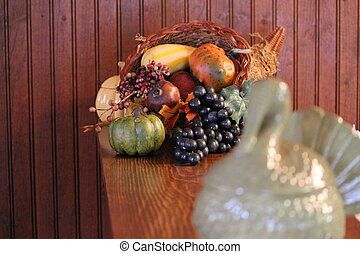 Thanksgiving at Home - Ceramic turkey and wicker horn of...
