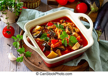 Thanksgiving Autumn Menu. Stewed meat with eggplant and eggplant vegetables on a rustic table.