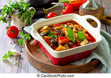 Thanksgiving Autumn Menu. Thanksgiving Autumn Menu. Stewed meat with eggplant and eggplant vegetables on a rustic table. Copy space