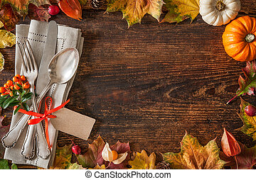 Thanksgiving autumn place setting with cutlery and...