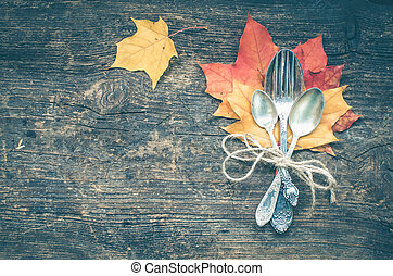 Thanksgiving autumn place setting with cutlery