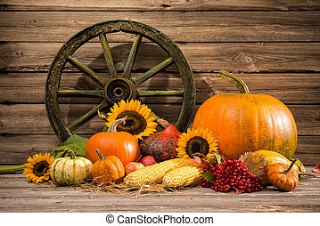 Thanksgiving autumnal still life with old wooden wheel