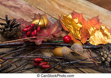 Thanksgiving background with acorns, golden and colorful maple leaves