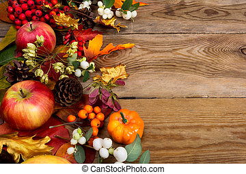 Thanksgiving background with apples, golden maple and oak leaves
