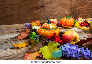 Thanksgiving background with leaves, ripe orange pumpkins, lilac flowers