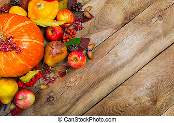 Thanksgiving background with pumpkin, apples and fall leaves, copy space.
