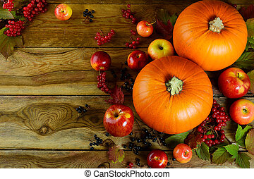 Thanksgiving background with pumpkins, berries and apples