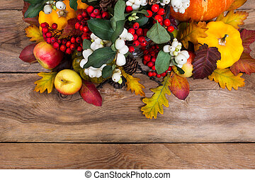 Thanksgiving background with rowan, apples, yellow squash, oak leaves, copy space
