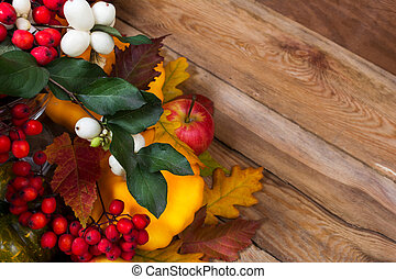 Thanksgiving background with snowberry, rowan, fall leaves