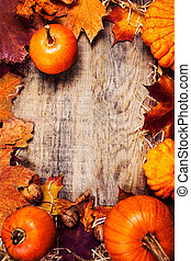 Thanksgiving border or frame with orange pumpkins and...