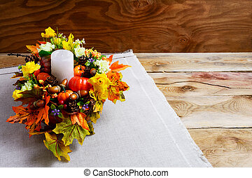 Thanksgiving centerpiece with artificial fall leaves