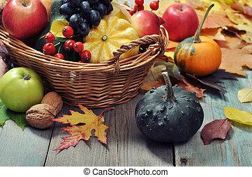 Thanksgiving concept - Fresh ripe pumpkins, apples, grape...
