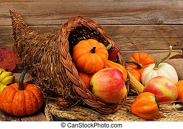 Thanksgiving cornucopia against rustic wood - Thanksgiving...