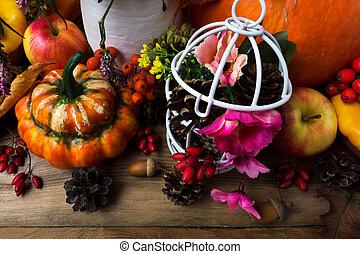 Thanksgiving decor with orange turban squash and birdcage