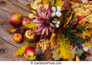 Thanksgiving decoration with silk flowers, snowberry and fall leaves