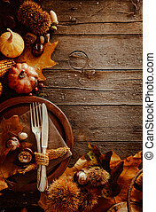 Thanksgiving dinner. Autumn fruit with plate and cutlery....